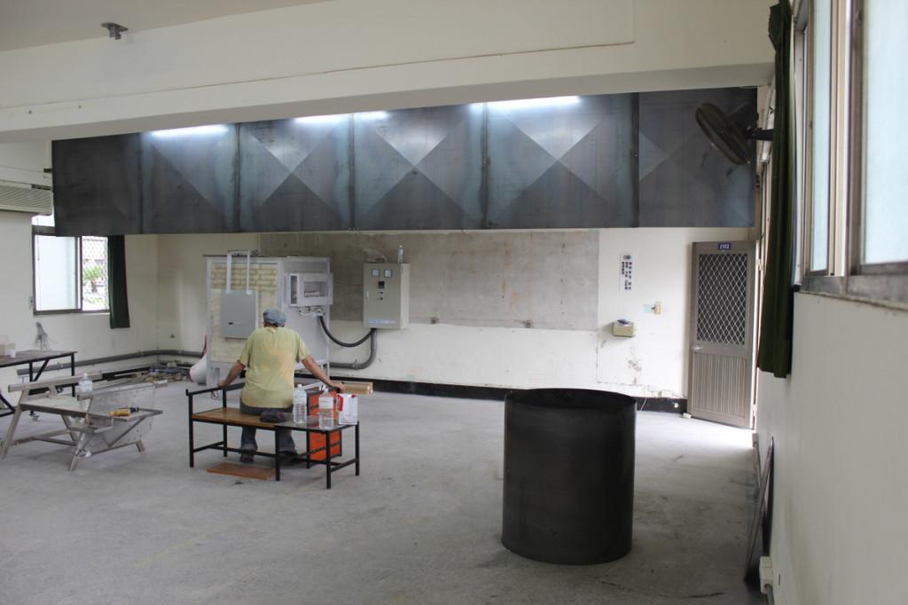 Hanging sheet metal for vent hood in glass studio.